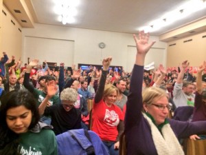 Hands go up as audience is asked if they will be out in the streets on MLK day, carrying the fight forward!